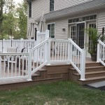 side view of wolf decking on two story pool deck with vinyl fencing