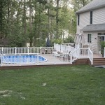 side view of completed wolf deck and white vinyl fence
