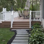 stone walk way leading to faux wood patio