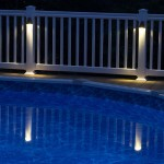 close up of pool lights on white vinyl fence
