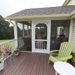 side view of screened in enclosed porch with wolf decking
