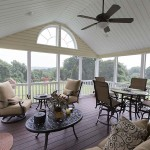 inside screened in porch deck that is furnished