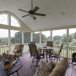 screened in porch deck with ceiling fan
