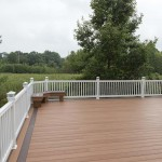 outdoor home deck with white vinyl railing