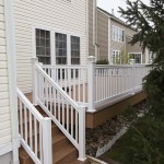 white vinyl railing and staircase on new deck