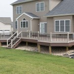 attached wolf deck with tan vinyl railing