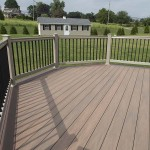 tan vinyl deck railing with black balusters