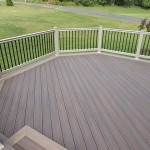 tan vinyl railing with black balusters around wolf deck