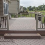 wolf deck step onto square wolf deck with vinyl railing around