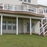 two story wolf deck with white vinyl railing