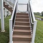 deck staircase with white vinyl railing