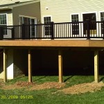 Light brown colored vinyl deck with black railing