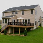 Suburban home in Spring City with Clubhouse Decking vinyl deck